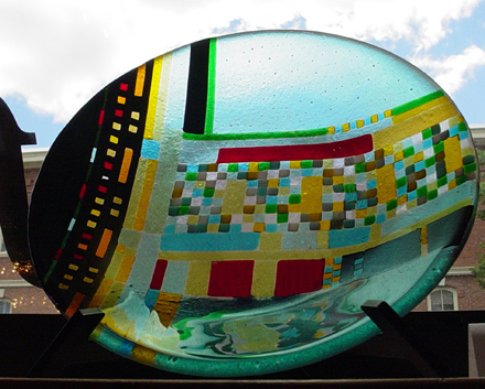 12 inch diameter fused glass bowl abstract with warm colors surrouned by cool by Joseph Tracy