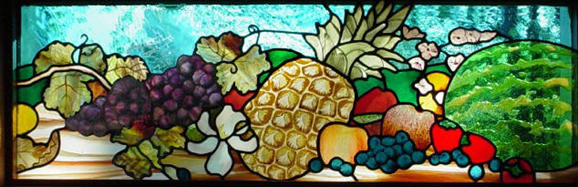 photo of stained glass with pineapple and cornucopia of fruit